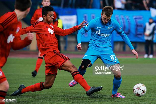 Pavel Dolgov of FC Zenit is challenged by Benjamin Henrichs of FC Leverkusen during the UEFA Youth League Group C match between FC Zenit St...