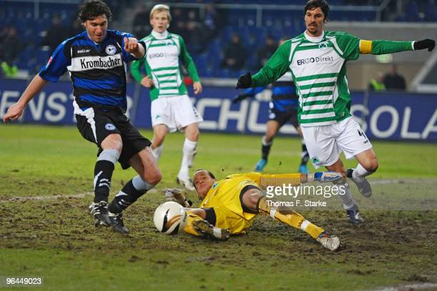 Pavel Fort of Bielefeld scores against Stephan Loboue and Marino Biliskov of Fuerth during the second Bundesliga match between Arminia Bielefeld and...