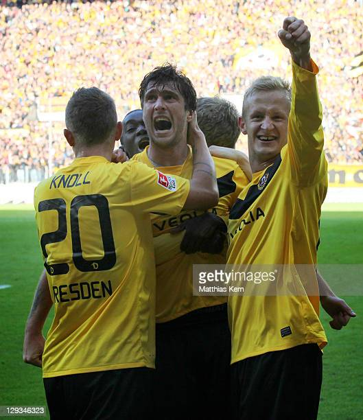 Pavel Fort of Dresden jubilates with team mates after scoring the second goal during the Second Bundesliga match between SG Dynamo Dresden and...