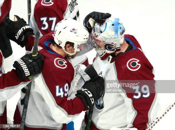 Pavel Francouz of the Colorado Avalanche is congratulated by teammate Samuel Girard of the Colorado Avalanche after Francouz recorded a shut out in...