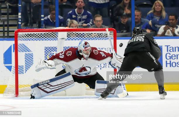 Pavel Francouz of the Colorado Avalanche makes a save on a penalty shot by Nikita Kucherov of the Tampa Bay Lightning during the third period at the...