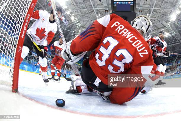 Pavel Francouz of the Czech Republic allows a goal against Andrew Ebbett of Canada in the first period during the Men's Bronze Medal Game on day...