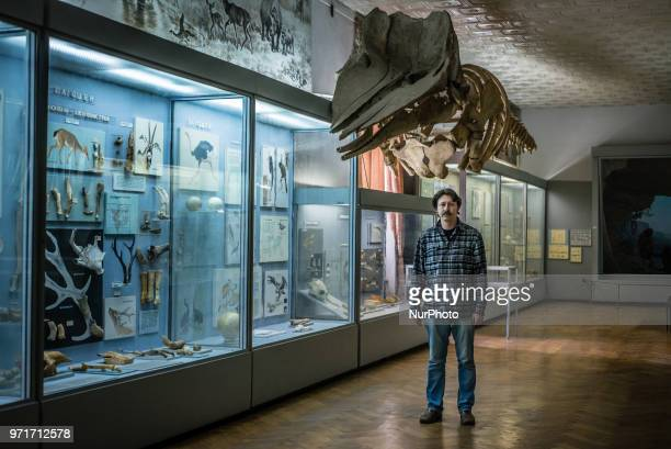 Pavel Goldin and the museum management examine the exhibit described by him in the National Museum of Natural History at the National Academy of...