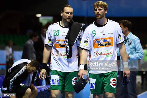 Pavel Horak and Manuel Spaeth of Goeppingen look dejected after the EHF Cup Semi Final match between Frisch Auf Goeppingen and RheinNeckar Loewen at...