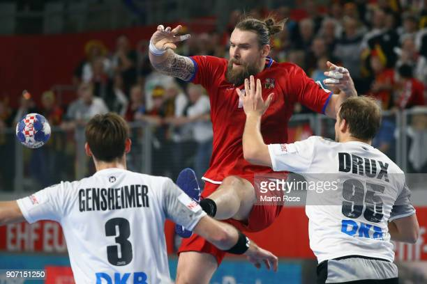Pavel Horak of Czech Republic is challenged by Paul Drux and Uwe Gensheimer of Germany during the Men's Handball European Championship main round...