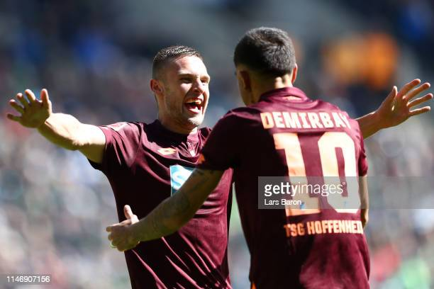 Pavel Kaderabek of 1899 Hoffenheim celebrates with teammate Kerem Demirbay after scoring his team's first goal during the Bundesliga match between...