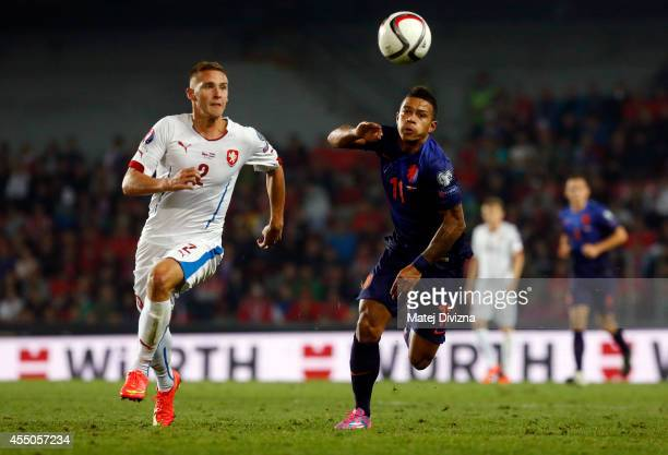 Pavel Kaderabek of Czech Republic competes for the ball with Memphis Depay of Netherlands during the UEFA EURO 2016 Group A Qualifier between Czech...
