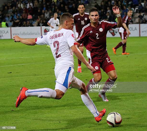 Pavel Kaderabek of Czech Republic vies with Latvia's Vitalijs Maksimenko during the Euro 2016 qualifying football match between Latvia and Czech...