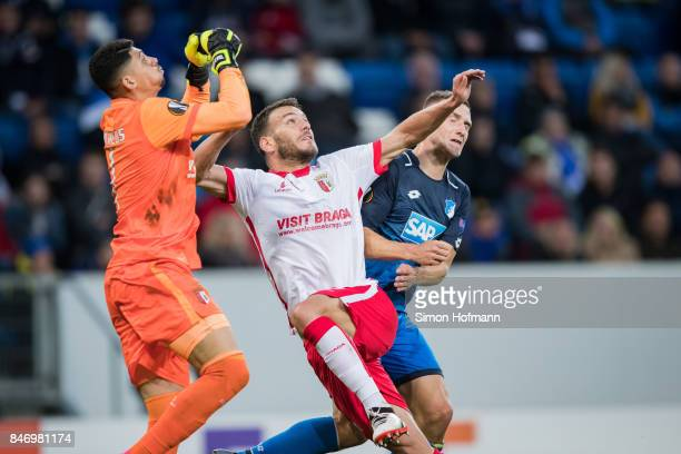 Pavel Kaderabek of Hoffenheim is challenged by Nuno Sequeiraand goalkeeper Matheus of Braga during the UEFA Europa League Group C match between 1899...
