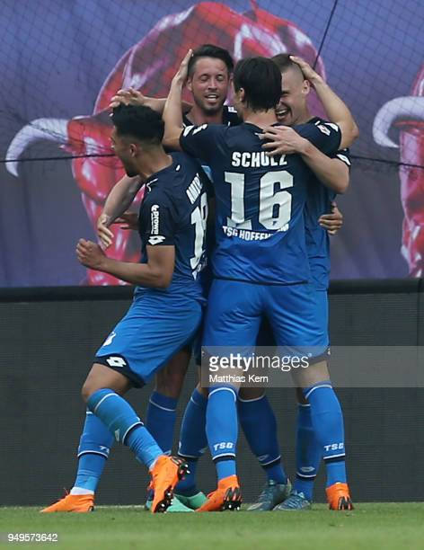 Pavel Kaderabek of Hoffenheim jubilates with team mates after scoring the third goal during the Bundesliga match between RB Leipzig and TSG 1899...