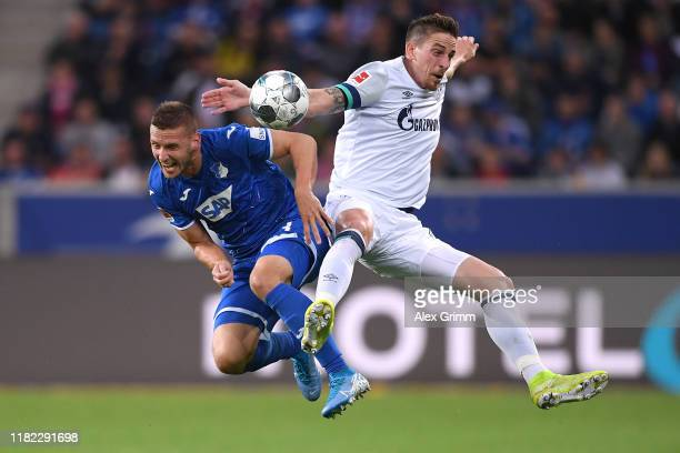 Pavel Kaderabek of Hoffenheim jumps for a header with Bastian Oczipka of Schalke during the Bundesliga match between TSG 1899 Hoffenheim and FC...