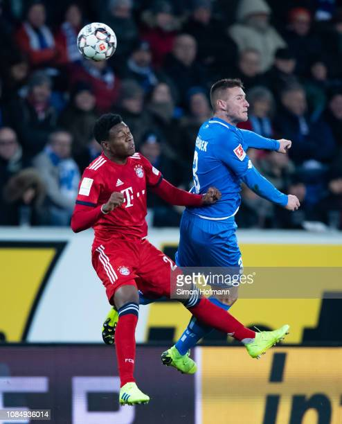 Pavel Kaderabek of Hoffenheim jumps for a header with David Alaba of Muenchen during the Bundesliga match between TSG 1899 Hoffenheim and FC Bayern...