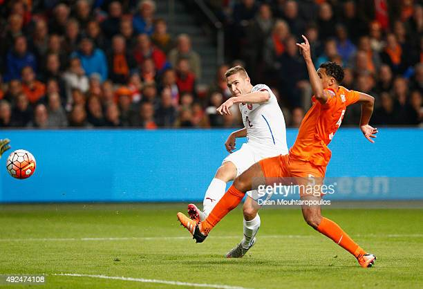 Pavel Kaderabek of the Czech Republic beats Jaïro Riedewald of the Netherlands to score their first goal during the UEFA EURO 2016 qualifying Group A...