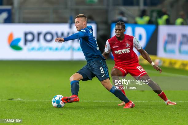 Pavel Kaderabek of TSG 1899 Hoffenheim and Kingsley Ehizibue of 1.FC Koeln battle for the ball during the Bundesliga match between TSG Hoffenheim and...