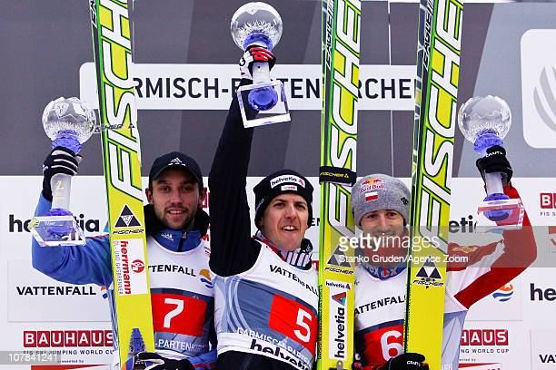 Pavel Karelin of Russia takes 2nd place Simon Ammann of Switzerland takes 1st placeAdam Malysz of Poland takes 3rd during during the FIS Ski Jumping...