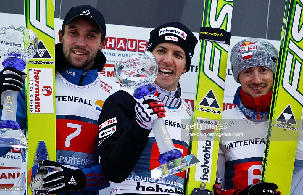 Pavel Karelin of Russia takes 2nd place, Simon Ammann of Switzerland takes 1st place,Adam Malysz of Poland takes 3rd during during the FIS Ski Jumping World Cup Vierschanzentournee (Four Hills Tournament) on January 1, 2011 in Garmisch-Partenkirchen, Germany.
