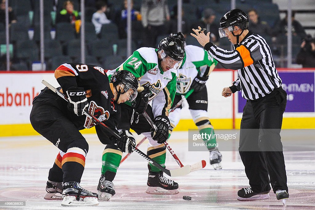 Pavel Karnaukhov #9 of the Calgary Hitmen faces off against Jordan Tkatch #24 of the Prince Albert Raiders during a WHL game at Scotiabank Saddledome on December 3, 2015 in Calgary, Alberta, Canada.