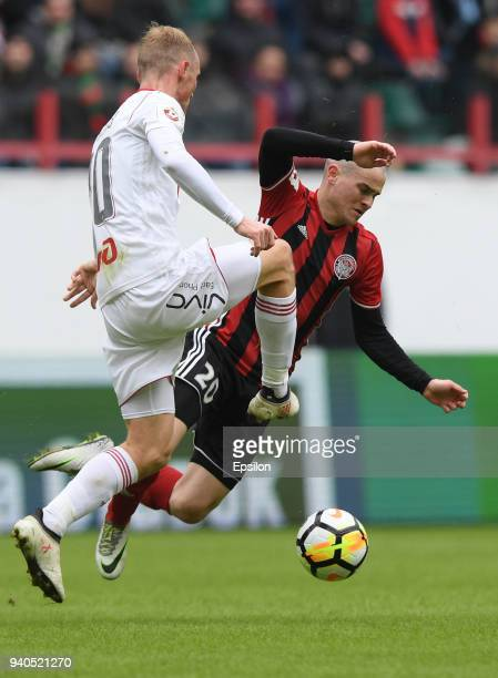 Pavel Komolov of FC Amkar Perm vies for the ball with Vladislav Ignatyev of FC Lokomotiv Moscow during the Russian Premier League match between FC...