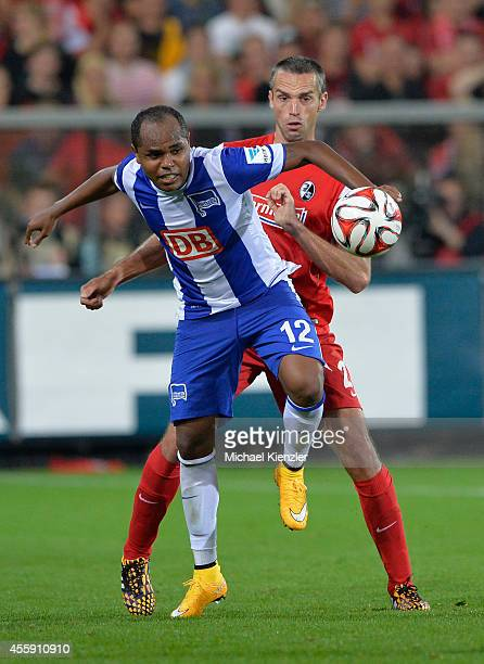 Pavel Krmas of Freiburg challenges Ronny of Hertha BSC during the Bundesliga match between SC Freiburg and Hertha BSC at Mage Solar Stadium on...
