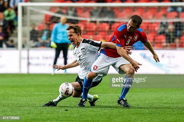 Pavel Kuka of Czech Republic battles for the ball with Jorg Heinrich of Germany during legends match between Czech Republic and Germany at Eden...