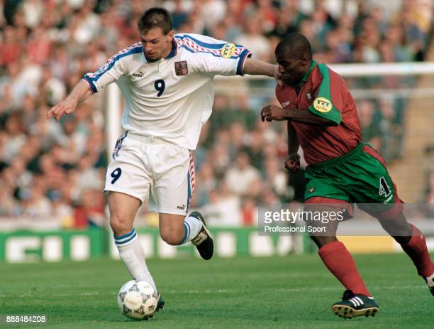 Pavel Kuka of Czech Republic holds off Oceano of Portugal during a UEFA Euro 96 Quarter Final at Villa Park on June 23 1996 in Birmingham England