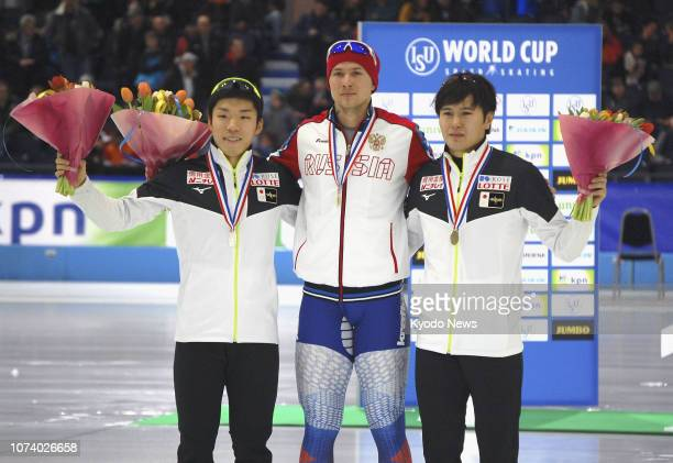 Pavel Kulizhnikov of Russia poses for a photo after winning the men's 500meter race at the World Cup event in Heerenveen the Netherlands in the early...