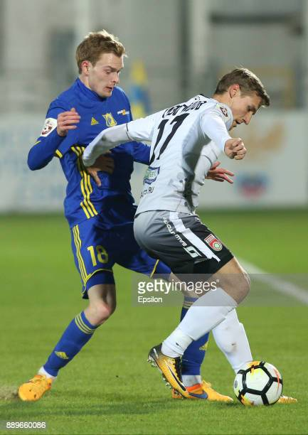 Pavel Mogilevets of FC Rostov RostovonDon vies for the ball with Dmitri Zhivoglyadov of FC Ufa during the Russian Premier League match between FC...