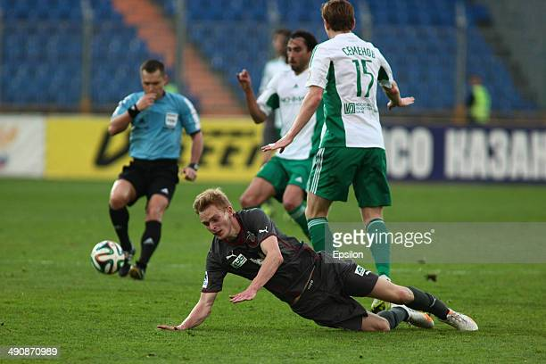 Pavel Mogilevets of FC Rubin Kazan is challenged by Andrei Semyonov of FC Terek Grozny during the Russian Football League Championship match between...