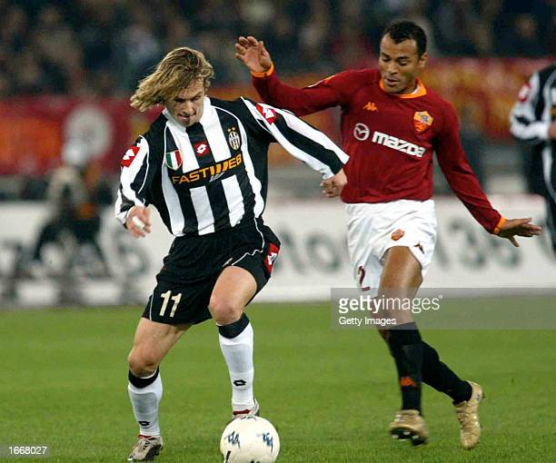 Pavel Nedved of Juventus and Cafu of Roma in action during the Serie A match between Roma and Juventus played at the Olympic Stadium Rome Italy on...