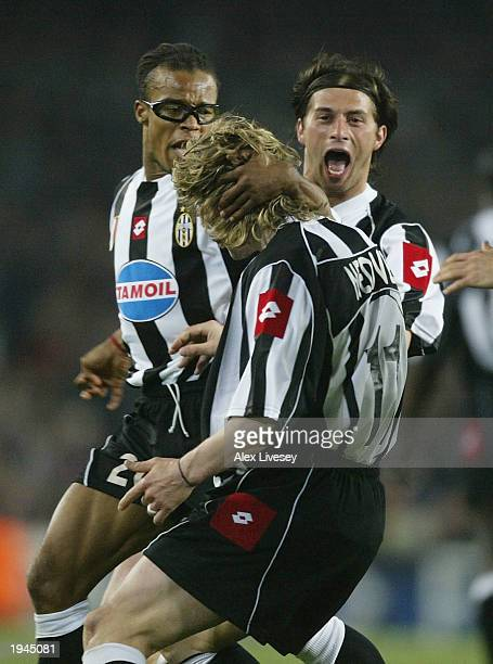 Pavel Nedved of Juventus celebrates his goal with Edgar Davids and Alessio Tacchinardi during the UEFA Champions League QuarterFinal second leg match...