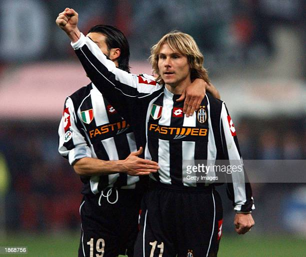 Pavel Nedved of Juventus celebrates scoring during the Serie A match between AC Milan and Juventus played at the Giuseppe Meazza San Siro Stadium...