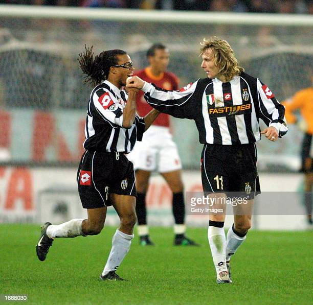 Pavel Nedved of Juventus celebrates with Edgar Davids after scoring during the Serie A match between Roma and Juventus played at the Olympic Stadium...