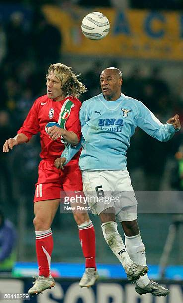 Pavel Nedved of Juventus goes up for a header against Ousmane Dabo of Lazio during the Serie A match between Lazio and Juventus at the Stadio...