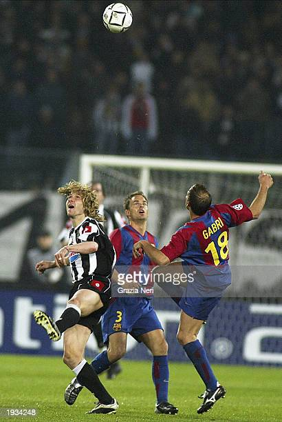 Pavel Nedved of Juventus is quickly closed down by Frank de Boer and Gabri of Barcelona in midfield during the UEFA Champions League quarterfinals...