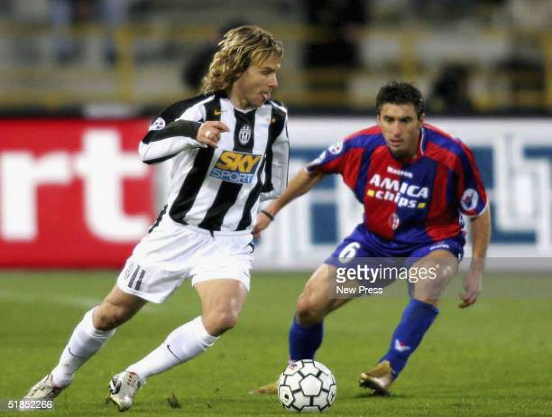 Pavel Nedved of Juventus is shadowed by Theodoras Zagorakis of Bologna during the Bologna v Juventus Serie A match played at the Renato Dall'Ara...