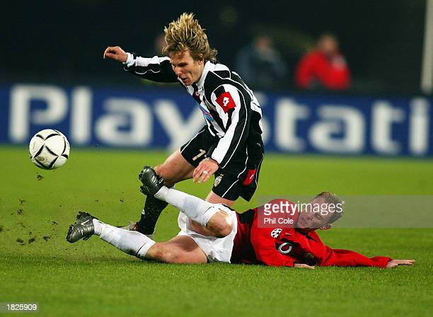 Pavel Nedved of Juventus is tackled by Nicky Butt of Manchester United during the UEFA Champions League Second Phase Group D match held on February...