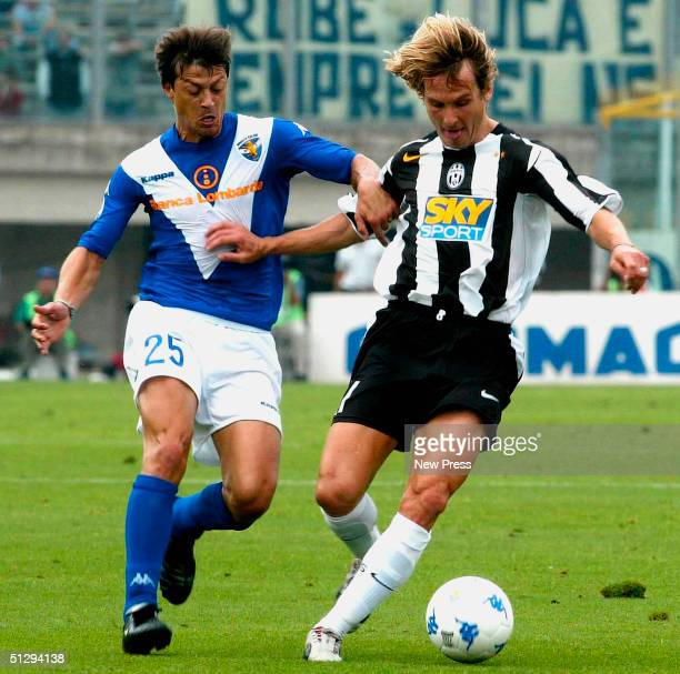 Pavel Nedved of Juventus resists a challenge from Matias Almeyda of Brescia during the Serie A match between Brescia and Juventus at Mario Rigamonti...