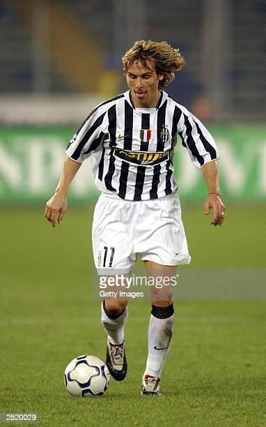 Pavel Nedved of Juventus runs with the ball during the Serie A match between Juventus and Roma at the Stadio Delle Alpi September 21 2003 in Turin...