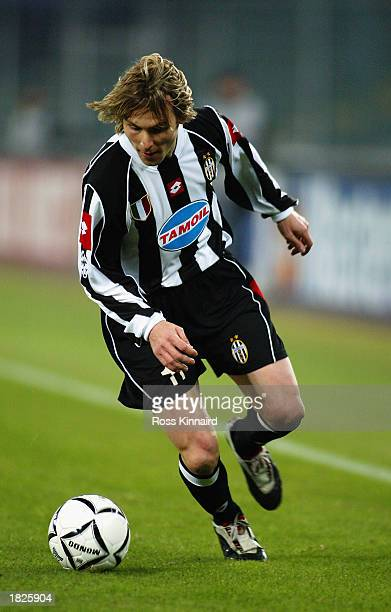 Pavel Nedved of Juventus runs with the ball during the UEFA Champions League Second Phase Group D match between Juventus and Manchester United held...