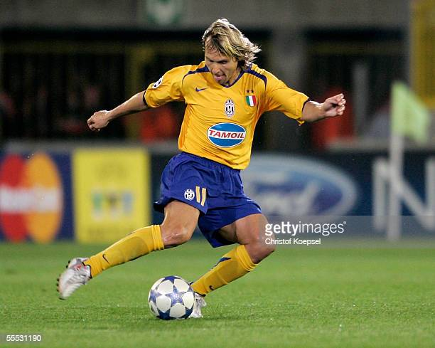 Pavel Nedved of Juventus shoots the ball during the UEFA Champions League preliminary round group A match between FC Bruges and Juventus Turin on...