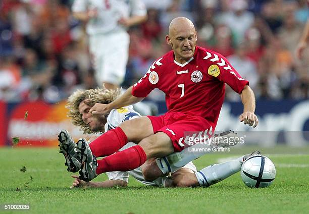 Pavel Nedved of the Czech Rep clashes with Thomas Gravesen of Denmark during the UEFA Euro 2004, Quarter Final match between Czech Republic and...