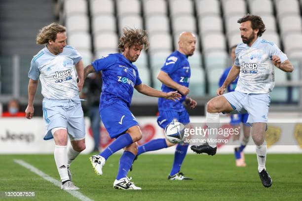 Pavel Nedved Vice President of Juventus looks on as Andrea Pirlo Head coach of Juventus challenges Davide Lippi Footballers agent and son of fomer...