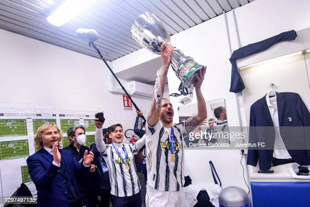 Pavel Nedved vice-president of Juventus, Paulo Dybala and Leonardo Bonucci celebrate with the trophy after winning the Italian PS5 Supercup after...
