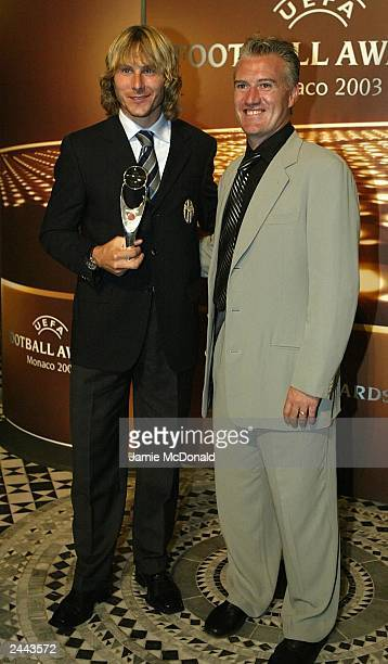Pavel Neved of Juventus with his award and Didier Deschamps during the UEFA Football awards at the Golf and Sporting Club on August 28 2003 in Monte...