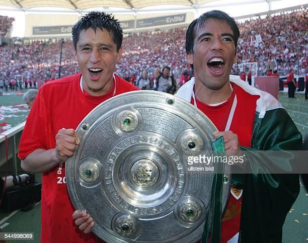 Pavel Pardo - Defender, VfB Stuttgart, Mexico - holding the Bundesliga trophy with team-mate Ricardo Osorio after winning the German championship