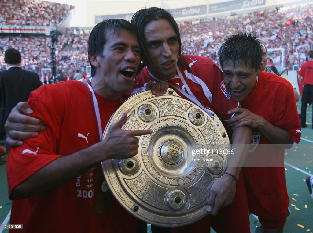 Pavel Pardo, Fernando Meira and Ricardo Osario of Stuttgart celebrate with the trophy after winning the german championship after the Bundesliga match between VFB Stuttgart and Energie Cottbus at the Gottlieb Daimler stadium on May 19, 2007 in Stuttgart, Germany.