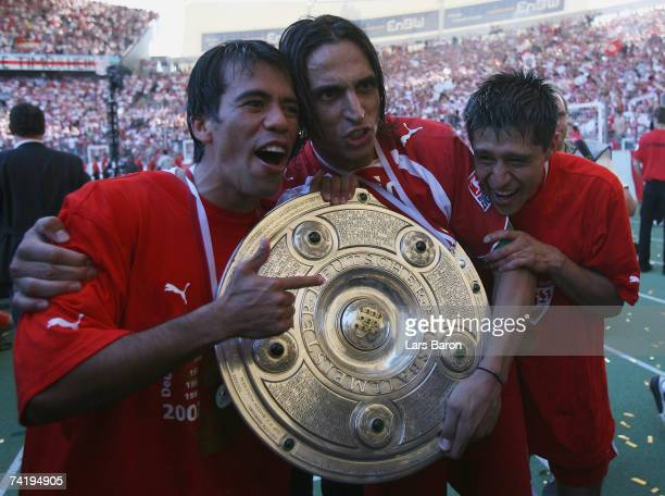 Pavel Pardo Fernando Meira and Ricardo Osario of Stuttgart celebrate with the trophy after winning the german championship after the Bundesliga match...
