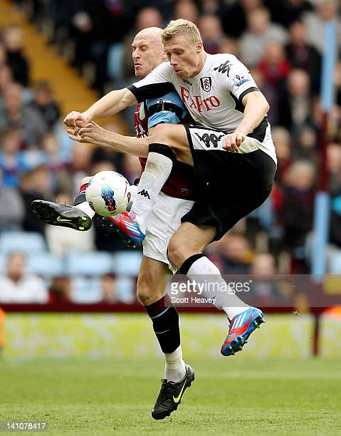 Pavel Pogrebnyak of FUlham in action with James Collins of Aston Villa during the Barclays Premier League match between Aston Villa and Fulham at...