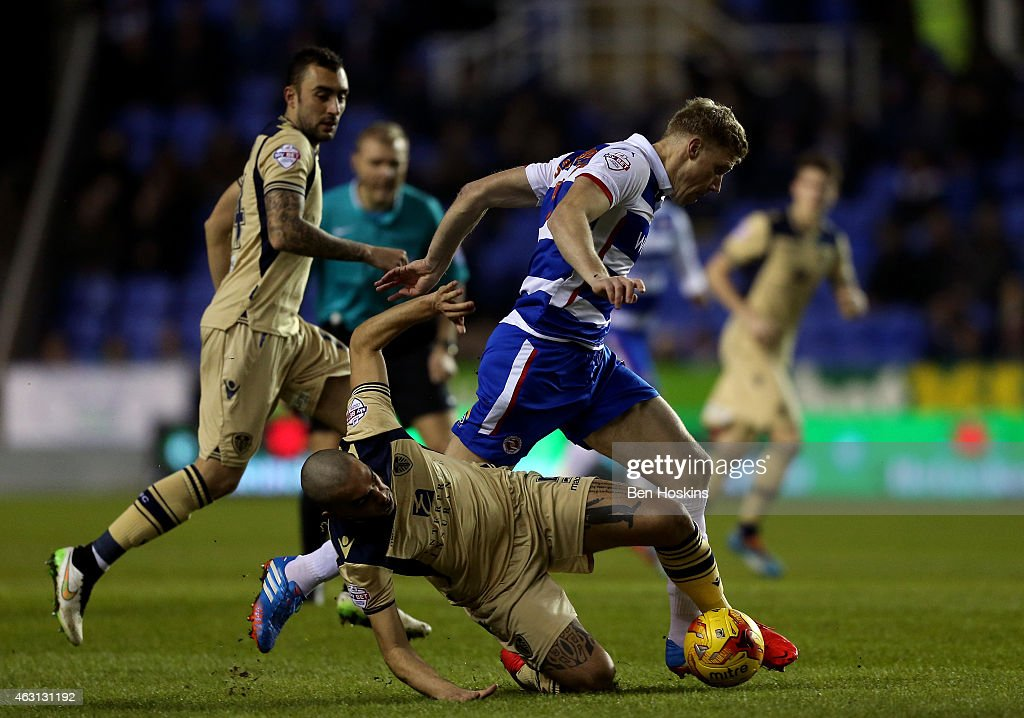 Pavel Pogrebnyak of Reading is tackled by Guiseppe Bellusci of Leeds during the Sky Bet Championship match between Reading and Leeds United at Madejski Stadium on February 10, 2015 in Reading, England.