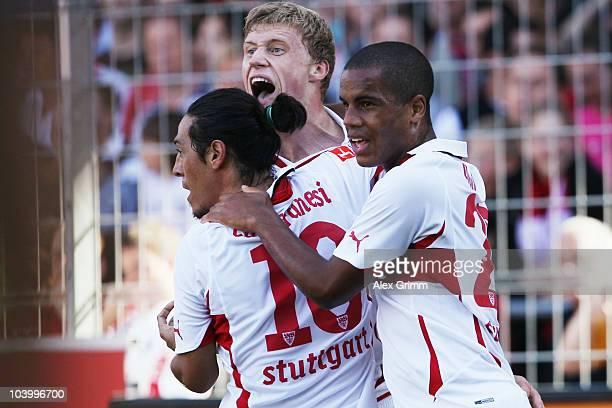 Pavel Pogrebnyak of Stuttgart celebrates his team's first goal with team mates Mauro Camoranesi and Daniel Didavi during the Bundesliga match between...